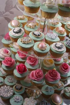 Edible jewellery and roses cupcakes. For more examples of our work visit www.elizabethscakeemporium.com
