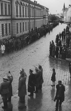 "Volunteers of 14.Waffen SS-Grenadier-Division ""Galizien"" march through Polish town en route to the depot. Civilians and uniformed officials salute them with the Nazi salute, May 1943."