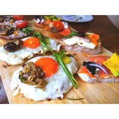Smorgasbord for breakfast. Sunny Side Up with Sauté Shroom, Salmon Avocado and Caviar with Wasabi Yogurt, Roasted Beef and Onion Marmalade. All topped on homemade Olive Bread. Olive Bread, Salmon Avocado, Marmalade, Roast Beef, Caviar, Camembert Cheese, Yogurt, Onion, Homemade