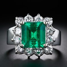 A big, bright and beautiful Colombian emerald, weighing 4.50 carats, blasts out brilliant green from within a frame of sparkling round brilliant-cut diamonds weighing 1.75 carats. Repin by Joanna MaGrath on Pinterest Rings