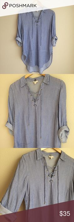 """Anthro cupio criss cross blue shirt size M Love this top's cute criss cross detail in the front. It's super flowy and long, making it a great casual piece. Super easy to throw on over some skinny jeans (I think white would be especially cute during spring/summer).   Measurements pit to pit 21"""" length 30""""  100% Viscose  Excellent condition. no flaws.  Size M fits true to size, would fit a size S oversized. Anthropologie Tops Tees - Long Sleeve"""