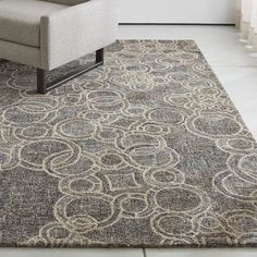 Shop Obi Slate Circle Pattern Rug.  Inspired by 18th-centured Sicilian tile designs, designer Mariella Ienna gives tradition a contemporary twist in a free-ranging chain pattern that plays with size and repetition.