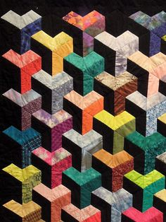 Quilt Inspiration: Quilts of illusion: tumbling blocks - it's all about the placement of the dark and light fabric - if you place a certain way, it looks like Ys.