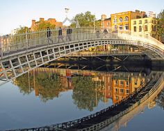 Ha'Penny Bridge. This pedestrian bridge over the River Liffey is one of Dublin's iconic sights. Accessed from Merchant's Arch, it is named after the ha'penny (half-penny) toll once needed to cross.