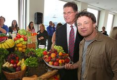 British Celebrity Chef Jamie Oliver holds a plate full of fresh fruit aloft with Premier of Victoria Ted Baillieu after announcing a partnership to attack state-wide obesity on March 6, 2012 in Melbourne, Australia. The Victorian Government and the Good Foundation will pledge together over AUD5 million to bring Oliver's 'Ministry of Food' to the state to help teach cooking techniques and nutrition to participants and help combat obesity as part of the Victorian Healthy Eating Enterprise.