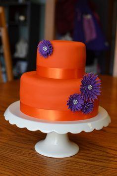 "Cake! Orange with Purple Daisies - 2-tier mini cake, orange with purple daisies, tiers were 4"" and 7"". Cake for daughters 5th b'day."