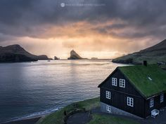 Dragon's Tooth under stormy sky, Vagar, Faroe Islands.