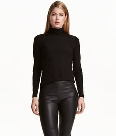 Black. Fitted turtleneck top in ribbed jersey with long sleeves.