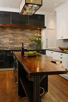 Live edgewood island countertop with matching wood beam inset into the metal hood fan.