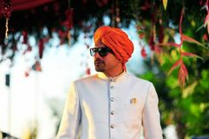 Orange pagdi on an ivory sherwani