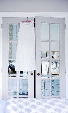 Dress up French doors by gluing on precut mirrors (found at craft and hardware stores).