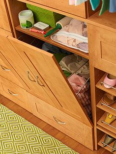 """Better Homes and Gardens - The Ultimate Walk-In Closet. Hidden Laundry Storage. """"Two joined door panels conceal a tilt-out hamper and mini laundry-prep station. A bag designated for delicate items and laundry essentials is stored on the shelf above for easy grab-and-go access."""""""