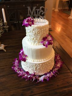 Piped buttercream with purple orchids