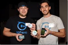 Cofounder Adam Wilson and Marketing Manager Chuck Lepley of Orbotix, showing off their Sphero robot.