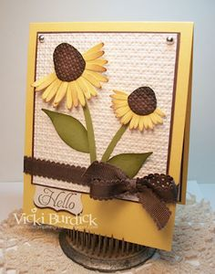 Love how the embossing folder was used for background texture and on the center of the flower.  This card would also look nice done in purple to resemble a purple coneflower.