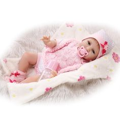 "79.47$  Watch here - http://ali0u2.worldwells.pw/go.php?t=32714155048 - ""22"""" silicone reborn dolls soft cloth body girl fashion dolls with pink rose clothing children birthday gift bonecas"""