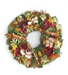 """16"""" dia. Apple And Cinnamon Wreath . $59.95. 16"""" dia. Apple And Cinnamon Wreath. Welcome guests to your home with a fragrant and festive wreath. All natural flowers and cinnamon stick bundles are designed around faux apple slices for a wreath that's as American as apple pie. Red maple leaves, myrtle, eucalyptus and natural leaves are entwined on a birch twig base. Decorative wreath with apples and cinnamon sticks All-natural flowers and leaves Use indoors or outs..."""