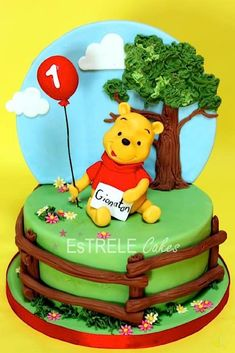 Fantastic Winnie the Pooh cake - love the fence detail - that could be used for all sorts of cakes