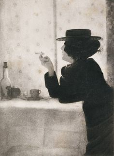 Robert Demachy photo, 1899.  a woman, alone, smoking at a cafe. She probably Reads.