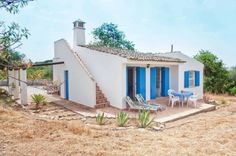 love the blue and white exterior - Algarve Tiny Rural Cottage in Portugal 001 Independent House, Tiny Cabins, Cabins And Cottages, Small Cottages, Villa, Rural Retreats, Natural Building, Tiny House On Wheels, Small House Plans