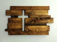 "Approximately 30x18. Each handmade piece is made to order. These beautiful rustic pieces are generally made of oak, cedar pine and reclaimed wood . Imperfections add to the character and charm of the pieces. We hand select and arrange the pieces to achieve just the right mix of color, texture and character. The thickness is generally ¾"" but widths vary. Each piece is finished with Danish Oil to bring out the character in the wood. Hangers are added to the back to allow easy hanging. We can…"