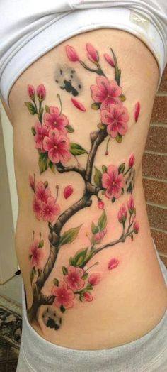 Realistic cherry blossom tattoo on side body