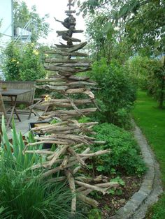 stick tree.. makes a trellis for an annual vine and winter yard art