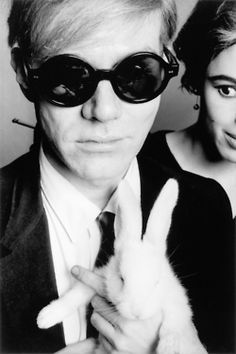 Andy Warhol, his muse Edie in the background...artsy fartsy and things of that nature.