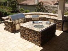 Gorgeous BBQ and outdoor kitchen with granite countertops, stainless steel appliances, and stone veneer. Created by Swink's Creations!