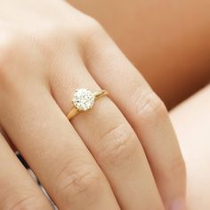 Beautiful old European cut diamond solitaire engagement ring with a smooth yellow gold band!