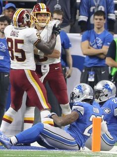 Redskins vs. Lions;   -   October 23, 2016  -  20-17, Lions  -     Washington Redskins QB Kirk Cousins celebrates his 19-yard go-ahead touchdown run with tight end Vernon Davis late in the fourth quarter against the Detroit Lions on Sunday, Oct. 23, 2016 at Ford Field in Detroit.  Kirthmon F. Dozier, DFP