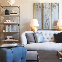 Alice Lane Home Collection    Living room vignette with tufted linen sofa and gold accents.