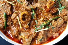 Mughlai Karahi Gosht Slow cooked lamb curry with tomatoes, garlic and garam masala