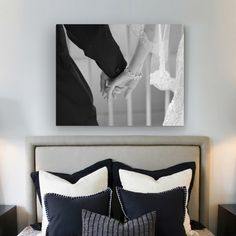 Hang a sentimental wedding picture above the bed