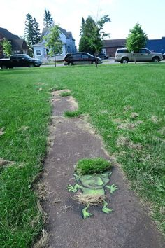 David Zinn:  How to draw a lawn troll in three easy steps. (Grass skirt optional.)