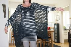 Black crocheted poncho. Decorated with handmade roses and leaves