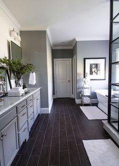 Gray walls, black floors, white accents- brilliant bathroom remodel with us on the PB Blog.