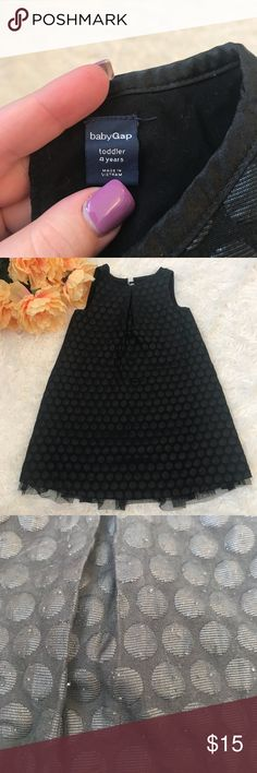 Black baby gap dress Polka dotted black Baby Gap dress. Has tulle underneath and three bows on the back. Slight piling all over as seen I. The pictures Baby Gap Dresses
