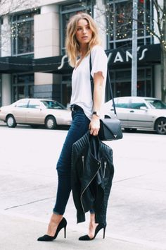 white tee, blue skinny jean, black pump, leather jacket and a black shoulder bag