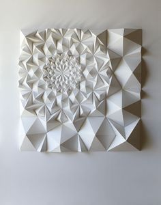Paper engineer Matthew Shlian has finalized new sculptures that are minimalist and rhythmical.