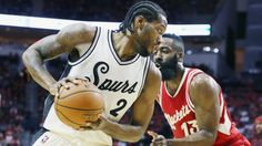 #NBA HOUSTON, TX - DECEMBER 25:  Kawhi Leonard #2 of the San Antonio Spurs and James Harden #13 of the Houston Rockets battle for position during their game at the Toyota Center on December 25, 2015 in Houston, Texas. NOTE TO USER: User expressly acknowledges and agrees that, by downloading and or using this Photograph, user is consenting to the terms and conditions of the Getty Images License Agreement.  (Photo by Scott Halleran/Getty Images)