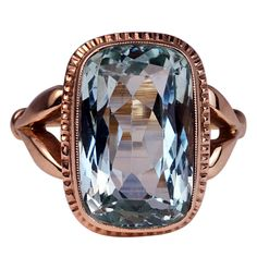 Russian Aquamarine Rose Gold Ring. A 9 carat cushion-cut aquamarine set in 14K rose gold. St. Petersburg, ca. 1908-1917.