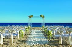 A beach wedding set-up at the Secrets Puerto Los Cabos