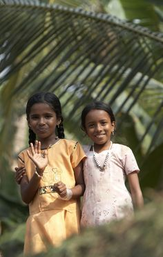 Cruising the backwaters in Kerala - Children from the village smiling waving at…