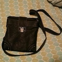 Rosetti faux leather black crossbody Black crossbody with 2 large pockets and a wallet-like center for cards/ID/cash. Snaps closed. Used once, in great conditon. Rosetti Bags Crossbody Bags