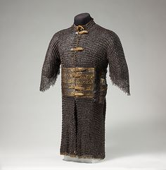Shirt of Mail and Plate                                                                                      Date:                                        15th century                                                          Culture:                                        Iranian                                                          Medium:                                        Steel, damascened with silver and partly gilt