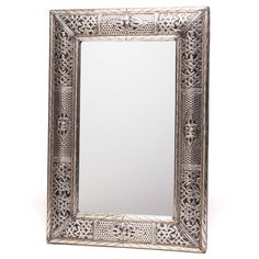 Made in Morocco, this beautiful handcrafted metalwork mirror features a silver-brass design perfect for your home. The indoor mirror can be displayed vertically or horizontally, giving you flexibility when you hang it in your favorite room.