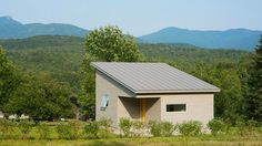 "Located near the Green Mountains, the simple, energy-efficient structure features a shed roof and a cubic form, but with two corners ""subtracted"" to create a porch entrance, and, on the opposite side, a dining nook of sorts"