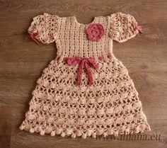 Ganchillo vestido está hecho de acrílico del color calabaza 75% lana y 25%.    Tiene cierre botón back, dobladillo estrecho, mangas cortas se reunieron,