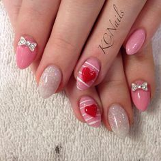 Pretty in pink. Almond acrylic nails. Pale pink, white glitter. 3D bows and red hand sculpted heart, painted stripes  KCNails